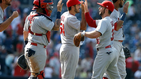 St. Louis Cardinals congratulate each other after their team defeated the San Diego Padres 2-0 in a baseball game in San Diego, Monday, Sept. 4, 2017. (AP Photo/Alex Gallardo)