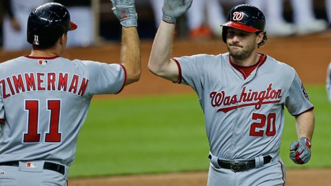 Washington Nationals' Daniel Murphy (20) is congratulated by Ryan Zimmerman (11) after Murphy hit a home run during the third inning of a baseball game against the Miami Marlins, Monday, Sept. 4, 2017, in Miami. (AP Photo/Wilfredo Lee)