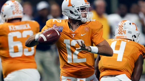 Tennessee quarterback Quinten Dormady (12) throws from the pocket in the first half of an NCAA college football game against the Georgia Tech, Monday, Sept. 4, 2017, in Atlanta. (AP Photo/John Bazemore)
