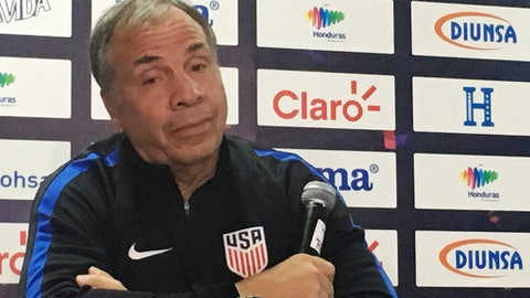 U.S. coach Bruce Arena speaks at a news conference at Estadio Olimpico Metropolitano in San Pedro Sula, Honduras, Monday, Sept. 4, 2017, ahead of a World Cup qualifier Tuesday. Arena thinks the divisive debate over immigration policy in the United States is firing up opposing players and fans. (AP Photo/Ron Blum)