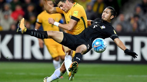 Australia's Tomi Juric, left and Thailand's Adisorn Promrak, right in action during their World Cup Group B qualifying soccer match in Melbourne, Australia, Tuesday, Sept. 05, 2017. (AP Photo/Andy Brownbill)