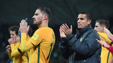 Australia's James Troisi, left and Tim Cahill thanks fans after their World Cup Group B qualifying soccer match against Thailand in Melbourne, Australia, Tuesday, Sept. 05, 2017. (AP Photo/Andy Brownbill)