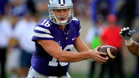 FILE - In this Saturday, Sept. 2, 2017, file photo, Kansas State quarterback Jesse Ertz plays against Central Arkansas during the first half of an NCAA college football game, in Manhattan, Kan. Ertz has overcome a season-ending knee injury, a bum throwing shoulder and stiff competition to become the starting quarterback for Kansas State. And make no mistake: The rest of the Wildcats are willing to follow him through just about anything.  (AP Photo/Orlin Wagner, File)
