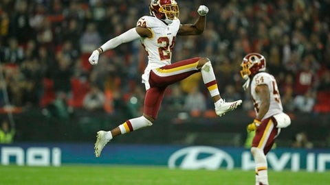 FILE - In this Oct. 30, 2016, file photo, Washington Redskins cornerback Josh Norman (24) celebrates a turnover during an NFL Football game against the Cincinnati Bengals, in London, England. Coming off a season in which he was the most penalized player in the NFL and didn't make the Pro Bowl, Josh Norman is licking his chops thinking about what's next. A different scheme under new defensive coordinator Greg Manusky has Norman and everyone else around the Washington Redskins thinking this is Norman's year to shine. (AP Photo/Matt Dunham, File)