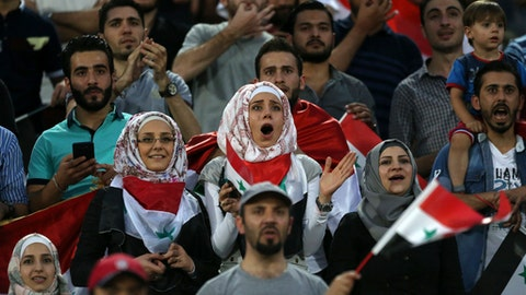 Syrian soccer fans follow their national team's match with Iran during their Round 3 - Group A World Cup qualifier at the Azadi Stadium in Tehran, Iran, Tuesday, Sept. 5, 2017. (AP Photo/Vahid Salemi)