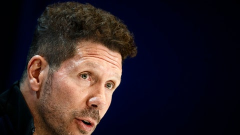 FILE - In this Tuesday, May 9, 2017 file photo, Atletico de Madrid head coach Diego Pablo Simeone speaks during a press conference before a training session ahead of the Champions League semifinal, 2nd leg soccer match between Atletico de Madrid and Real Madrid at the Vicente Calderon stadium, in Madrid, Spain. Atletico Madrid says it has reached a deal to extend Simeone's contract for two more seasons, keeping him at the club until the end of the 2020 season, it was reported on Tuesday, Sept. 5, 2017.  (AP Photo/Daniel Ochoa de Olza, File)