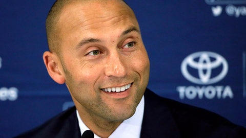 FILE - In this Sept. 28, 2014, file photo, New York Yankees' Derek Jeter speaks to the media after the last baseball game of his career, against the Boston Red Sox, at Fenway Park in Boston. Derek Jeter and Bruce Sherman are holding meetings Tuesday and Wednesday, Sept. 5-6, 2017,  at Marlins Park to ease the transition in their investment group's pending purchase of the Miami Marlins, a person familiar with the discussions said. The person confirmed the meetings to The Associated Press on condition of anonymity because those involved have not commented. (AP Photo/Steven Senne, File)