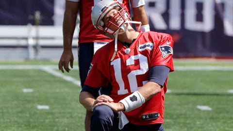 New England Patriots quarterbacks Tom Brady (12) and Jimmy Garoppolo (10) warm up during an NFL football practice, Tuesday, Sept. 5, 2017, in Foxborough, Mass. (AP Photo/Steven Senne)