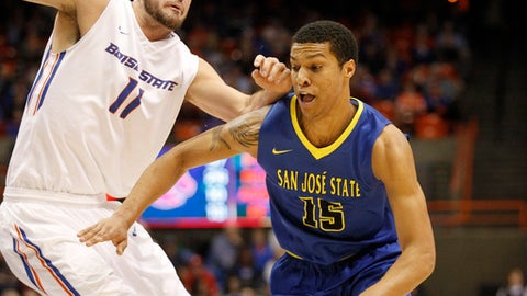 San Jose State's Brandon Clarke (15) moves the ball around Boise State's Zach Haney (11) during the second half of an NCAA college basketball game in Boise, Idaho, Saturday, Feb. 25, 2017. Boise State won 85-78. (AP Photo/Otto Kitsinger)