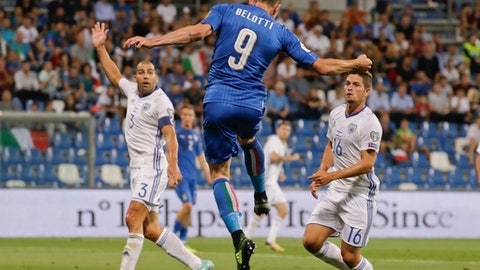 Italy's Andrea Belotti heads the ball during the World Cup Group G qualifying soccer match between Italy and Israel at the Mapei Stadium in Reggio Emilia, Italy, Tuesday, Sept. 5, 2017. (AP Photo/Luca Bruno)