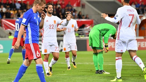 Spain's Isco, centre left, and Alvaro Morata, right, react after scoring to take teh score to 0-3, with Liechtenstein's goalkeeper Peter Jehle, 2nd right, during the 2018 Fifa World Cup Russia group G qualification soccer match between Liechtenstein and Spain at the Rheinpark stadium in Vaduz, Liechtenstein, on Tuesday, Sept. 5, 2017. (Gian Ehrenzeller/Keystone via AP)