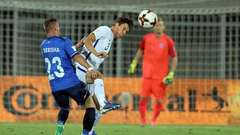 Kosovo's Bernard Berisha, right, fights for the ball with Finland's Sauli Vaisanen during the World Cup Group I qualifying soccer match between Kosovo and Finland at Loro Borici stadium, in Shkoder, northern Albania, Tuesday, Sept. 5, 2017. (AP Photo/Hektor Pustina)