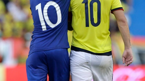 Brazil's Neymar, left, and Colombia's James Rodriguez embrace at the end a 2018 Russia World Cup qualifying soccer match at the Roberto Melendez stadium in Barranquilla, Colombia, Tuesday, Sept. 5, 2017. The match ended in a 1-1 tie. (AP Photo/Fernando Vergara)
