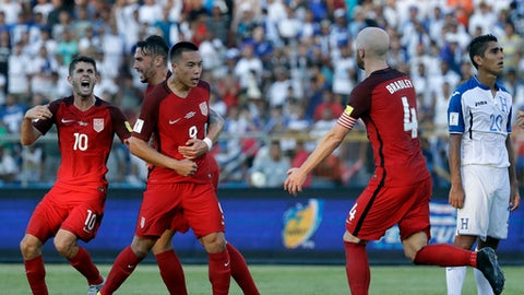 United States' Bobby Wood, 9, celebrates with teammates after scoring his team's first goal during a 2018 World Cup qualifying soccer match against Honduras in San Pedro Sula, Honduras, Tuesday, Sept. 5, 2017. (AP Photo/Rebecca Blackwell)