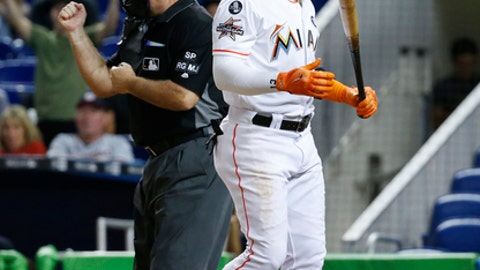 Miami Marlins' Marcell Ozuna reacts after striking out during the first inning of a baseball game against the Washington Nationals, Tuesday, Sept. 5, 2017, in Miami. (AP Photo/Wilfredo Lee)