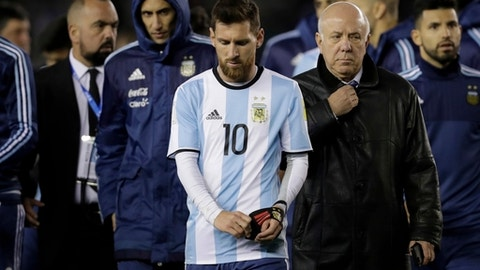 Argentina's Lionel Messi, center, leave the field at the end of the 2018 World Cup qualifying soccer match against Venezuela in Buenos Aires, Argentina, Tuesday, Sept. 5, 2017. Argentina and Venezuela tied 1-1. (AP Photo/Victor R. Caivano)