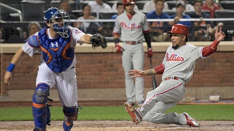 Philadelphia Phillies' J.P. Crawford scores on single by Ben Lively as New York Mets catcher Travis d'Arnaud, left, takes the throw during the second inning of a baseball game, Tuesday, Sept. 5, 2017, at Citi Field in New York. (AP Photo/Bill Kostroun)