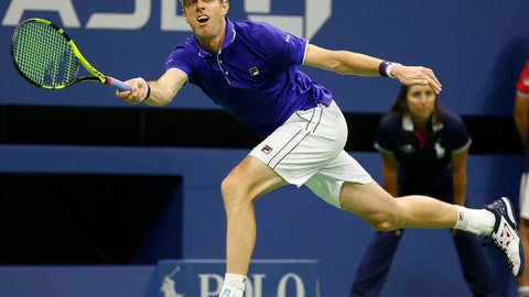 Sam Querrey, of the United States, runs down a shot during the second-set tiebreak in a quarterfinal against Kevin Anderson, of South Africa, at the U.S. Open tennis tournament in New York, Tuesday, Sept. 5, 2017. (AP Photo/Kathy Willens)