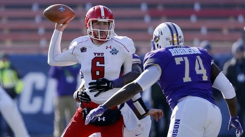 James Madison defensive lineman Simeyon Robinson (74) and a teammate, rear, pressure Youngstown State quarterback Hunter Wells (6) as Wells throws a pass in the first half of the FCS championship NCAA college football game, Saturday, Jan. 7, 2017, in Frisco, Texas. (AP Photo/Tony Gutierrez)