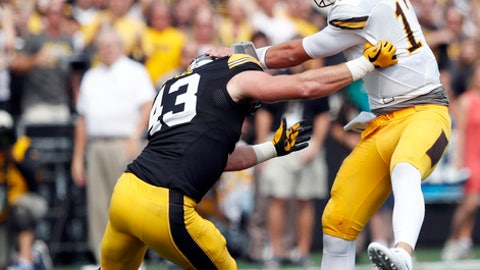 FILE - In this Sept. 2, 2017, file photo, Wyoming quarterback Josh Allen is sacked by Iowa linebacker Josey Jewell, left, during the first half of an NCAA college football game, in Iowa City, Iowa. This year's Iowa-Iowa State game might feature as much in-state talent as any matchup in recent memory. (AP Photo/Charlie Neibergall, FIle)