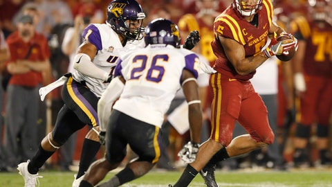 FILE - In this Sept. 2, 2017, file photo, Iowa State wide receiver Allen Lazard, right, runs from Northern Iowa's Elijah Campbell, left, and Isaiah Nimmers (26) after making a reception during the second half of an NCAA college football game, in Ames, Iowa. This year's Iowa-Iowa State game might feature as much in-state talent as any matchup in recent memory. (AP Photo/Charlie Neibergall, File)