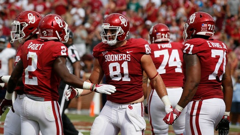 FILE - In this Sept. 2, 2017,  file photo, Oklahoma tight end Mark Andrews (81) celebrates a touchdown with teammates during an NCAA college football game against UTEP, in Norman, Okla. Oklahoma and Ohio State will play for the fourth time and the first at the Horseshoe since the Sooners only visit in 1977. That game was, like this one between the second-ranked Buckeyes and fifth-ranked Sooners, a top-five matchup. (AP Photo/Sue Ogrocki, File)
