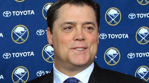 """FILE - In this Jan. 9, 2014, file photo, Pat LaFontaine poses after a news conference in Buffalo N.Y. The NHL and NHL Players' Association have unveiled a """"Declaration of Principles"""" to guide hockey culture across various levels of the sport. Hockey Hall of Famer Pat LaFontaine, now the league's vice president of hockey development, was a driver behind the process. (AP Photo/Nick LoVerde, File)"""