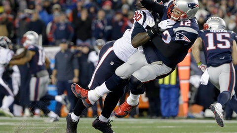 FILE - In this Jan. 14, 2017, file photo, Houston Texans defensive end Jadeveon Clowney (90) levels New England Patriots quarterback Tom Brady (12) after Brady released a pass during the first half of an NFL divisional playoff football game, in Foxborough, Mass. The NFL and the players' union have found no evidence of deviation by New England's medical staff from the league's concussion protocol regarding Tom Brady last season. League spokesman Brian McCarthy said in a statement Wednesday, Sept. 6, 2017, that Brady released his medical records for review as part of the process. (AP Photo/Elise Amendola, File)