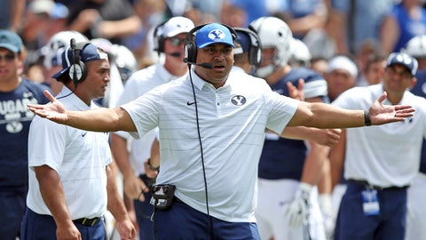 FILE - In this Aug. 26, 2017, file photo, BYU head coach Kalani Sitake reacts on the sideline in the first half of an NCAA college football game against Portland State, in Provo, Utah. Sitake didn't hesitate to that say a change is needed on the offensive side of the ball after the Cougars had one of the worst outings in recent history last weekend. (AP Photo/Rick Bowmer, File)