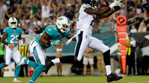 FILE - In this Aug. 24, 2017, file photo, Philadelphia Eagles' Alshon Jeffery, right, scores a touchdown past Miami Dolphins' Nate Allen during the first half of a preseason NFL football game, in Philadelphia. Alshon Jeffery, Torrey Smith and LeGarrette Blount bring impressive resumes to the Philadelphia Eagles. Now, it's time to make an impact on the field. The Eagles gave their offense a makeover in the offseason, surrounding Carson Wentz with better talent by adding three accomplished starters at skill positions. But the trio of veterans need to prove they're not past their prime.(AP Photo/Michael Perez, FIle)
