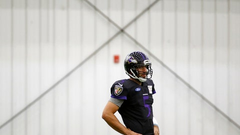 Baltimore Ravens quarterback Joe Flacco walks on an indoor field during an NFL football practice in Owings Mills, Md., Wednesday, Sept. 6, 2017. Flacco is combining all of training camp and four preseason games into one week of practice before testing his ailing back for the first time in Sunday's season opener at Cincinnati. (AP Photo/Patrick Semansky)