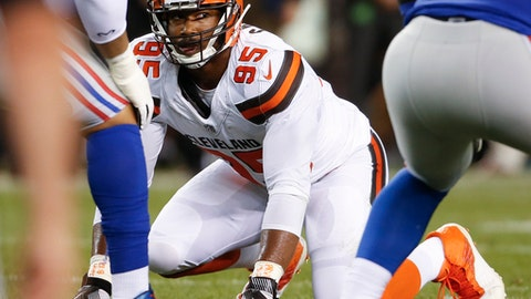 """FILE - In this Aug. 21, 2017, file photo, Cleveland Browns defensive end Myles Garrett (95) plays against the New York Giants during the first half of an NFL preseason football game,in Cleveland. As he prepares for his NFL debut, Browns rookie Myles Garrett says he's viewing Steelers quarterback Ben Roethlisberger as """"just another guy."""" The top overall pick isn't backing down from his comment after the draft that he plans to sack Big Ben when Cleveland opens the regular season on Sunday against the Pittsburgh Steelers. (AP Photo/Ron Schwane, File)"""