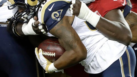 File- This Sept. 12, 2017, file photo shows San Francisco 49ers defensive end Quinton Dial (92) tackling Los Angeles Rams running back Todd Gurley during the first half of an NFL football game in Santa Clara, Calif. So many new veterans for the Green Bay Packers. At their core, the Packers still build through the draft. But general manager Ted Thompson has been more active than usual this season in signing veteran free agents. Dial, a 6-foot-5, 318-pound defensive lineman who signed on Tuesday, Sept. 5, 2017, after being released by the San Francisco 49ers.  (AP Photo/Marcio Jose Sanchez, File)