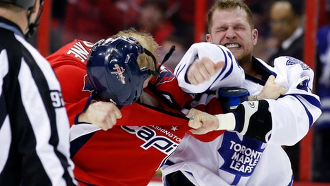 """FILE - In this Jan. 10, 2014, file photo, Washington Capitals defenseman John Erskine (4) loses his helmet in a fight with Toronto Maple Leafs right wing Colton Orr during an NHL hockey game in Washington. """"It's not always easy when you retire from something that you did for so long, that was your livelihood and everything you've done since you were a kid,"""" said Orr,, who retired in April. (AP Photo/Alex Brandon, File)"""