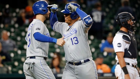 Kansas City Royals' Salvador Perez (13) celebrates his two-run home run with Eric Hosmer (35) against the Detroit Tigers in the eighth inning of a baseball game in Detroit, Wednesday, Sept. 6, 2017. (AP Photo/Paul Sancya)