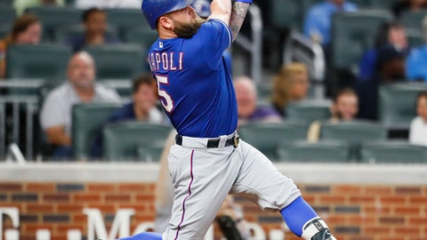 Texas Rangers pinch-hitter Mike Napoli hits a single during the ninth inning of the second game of a baseball doubleheader against the Atlanta Braves, Wednesday, Sept. 6, 2017, in Atlanta. The Braves won 5-4. (AP Photo/Todd Kirkland)