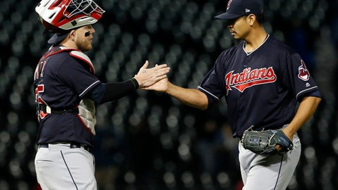 Cleveland Indians starting pitcher Carlos Carrasco, right, celebrates with catcher Roberto Perez after the Indians defeated the Chicago White Sox 5-1 in a baseball game Wednesday, Sept. 6, 2017, in Chicago. (AP Photo/Nam Y. Huh)
