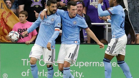 New York City FC's David Villa (7) celebrates his first half goal against Orlando City with teammates Jack Harrison (11), Rodney Wallace (23) and Maximiliano Moralez (10) in an MLS soccer game, Sunday, May 21, 2017, in Orlando, Fla. (AP Photo/John Raoux)