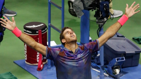 Juan Martin del Potro, of Argentina, celebrates after defeating Roger Federer, of Switzerland, in a quarterfinal match at the U.S. Open tennis tournament in New York, Wednesday, Sept. 6, 2017. (AP Photo/Kathy Willens)