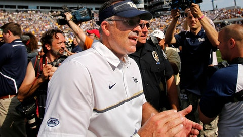 FILE - In this Sept. 10, 2016, file photo, Pittsburgh head coach Pat Narduzzi, center, celebrates after a 42-39 win over Penn State in an NCAA college football game in Pittsburgh. Pittsburgh looks to give the ACC some credibility in a visit to No. 4 Penn State on Saturday. (AP Photo/Gene J. Puskar)