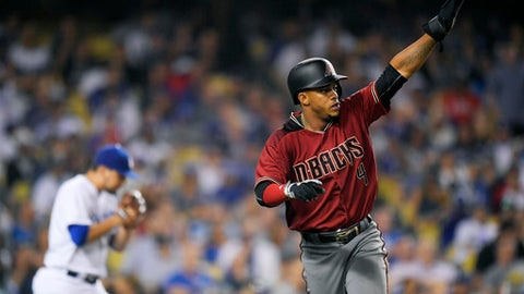 Arizona Diamondbacks' Ketel Marte, right, gestures toward second after scoring on a double by Adam Rosales as Los Angeles Dodgers relief pitcher Luis Avilan walks back to the mound during the seventh inning of a baseball game, Wednesday, Sept. 6, 2017, in Los Angeles. (AP Photo/Mark J. Terrill)