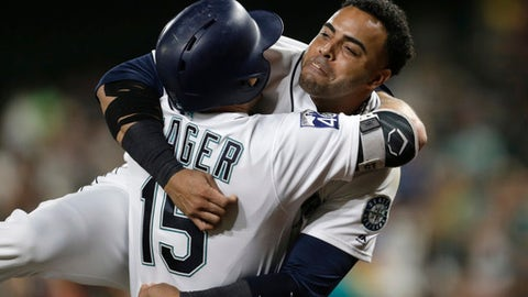 Seattle Mariners' Nelson Cruz hugs Kyle Seager after Seager hit a solo home run on a pitch from Houston Astros starting pitcher Lance McCullers Jr. during the fifth inning of a baseball game Wednesday, Sept. 6, 2017, in Seattle. (AP Photo/John Froschauer)