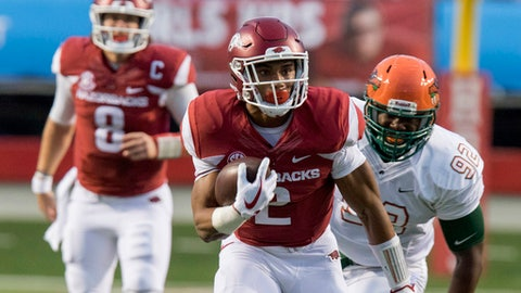 FILE - In this Aug. 31, 2017, file photo, Arkansas running back Chase Hayden (2) runs down the field as Florida A&M defensive end Atreus Martin (92) pursues during an NCAA college football game in Little Rock, Ark. Arkansas plays TCU this week. The Horned Frogs are so loaded at linebacker that Ty Summers was moved to end a year after ranking second on the team and in the Big 12 with 121 tackles. With the quick emergence of true freshman Hayden (120 yards on 14 carries in his debut) and addition of South Carolina transfer David Williams, the Razorbacks have three solid runners .(AP Photo/Gareth Patterson, File)