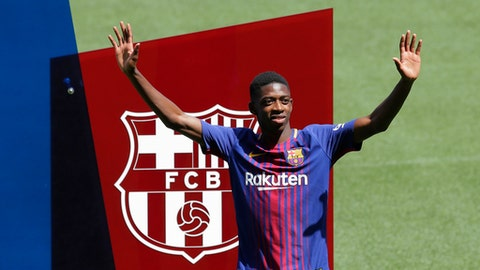 FILE  - In this Monday, Aug. 28, 2017 file photo, French soccer player Ousmane Dembele gestures during official presentation at the Camp Nou stadium in Barcelona, Spain. Dembele, the 20-year-old France striker signed by Barcelona to replace Neymar is expected to make his debut in the Catalan derby against Espanyol on Saturday, Sept. 9, 2017. (AP Photo/Manu Fernandez, File)