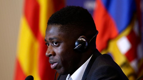 FILE - In this Monday, Aug. 28, 2017 file photo, Barcelona's new signing player Ousmane Dembele speaks during a press conference of his official presentation at the Camp Nou stadium in Barcelona, Spain. Dembele, the 20-year-old France striker signed by Barcelona to replace Neymar is expected to make his debut in the Catalan derby against Espanyol on Saturday, Sept. 9, 2017. (AP Photo/Manu Fernandez, File)