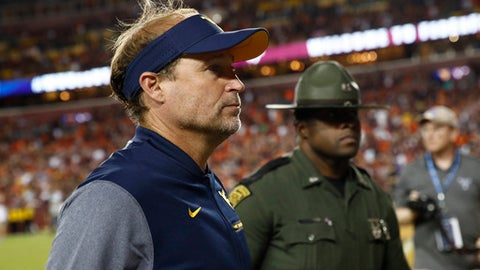 FILE - In this Sept. 3, 2017, file photo, West Virginia head coach Dana Holgorsen walks off the field after a 31-24 loss in an NCAA college football game against Virginia Tech, in Landover, Md. Holgorsen leads West Virginia into its home opener Saturday against East Carolina in Morgantown, West Virginia .(AP Photo/Patrick Semansky, File)
