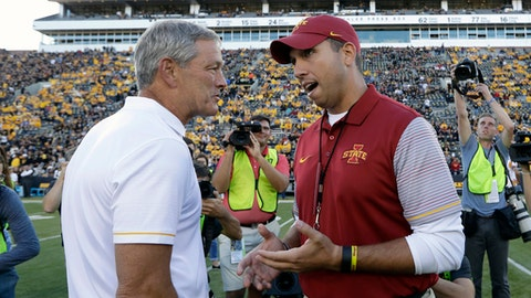 FILE - In this Sept. 10, 2016, file photo, Iowa coach Kirk Ferentz, left, talks with Iowa State coach Matt Campbell before an NCAA college football game, in Iowa City, Iowa. Iowa and Iowa State play Saturday in Ames. (AP Photo/Charlie Neibergall)