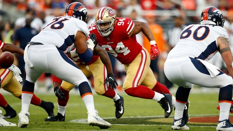 FILE - In this Aug. 19, 2017, file photo, San Francisco 49ers defensive lineman Solomon Thomas (94) moves off the line during the first half of a preseason NFL football game against the Denver Broncos in Santa Clara, Calif. Thomas shared a suite with Christian McCaffrey in college together Stanford, played heated games against him in Connect Four and helped lead the Cardinal to great success on the field as future top 10 picks in the NFL draft. With players set to make their pro debut Sunday when McCaffrey and Carolina visit Thomas and San Francisco, the 49ers rookie defensive lineman will get the opportunity to do something he always wanted at practice in college: tackle McCaffrey. (AP Photo/D. Ross Cameron, File)