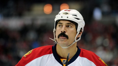 FILE - This is a Feb. 9, 2013, file photo showing Florida Panthers right wing George Parros during the third period of an NHL hockey game against the Washington Capitals, in Washington. The NHL has tabbed former enforcer George Parros to run its department of player safety. Commissioner Gary Bettman announced Parros' appointment to senior vice president of player safety on Thursday, Sept. 7, 2017. (AP Photo/Nick Wass, File)