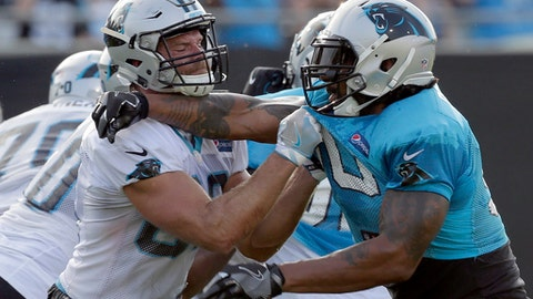 FILE - In this July 26, 2017, file photo, Carolina Panthers' Julius Peppers, right, battles Greg Olsen during practice at NFL football training camp at Wofford College in Spartanburg, S.C. Thirty-seven-year-old defensive end Julius Peppers is back with the Panthers after seven seasons playing with the Chicago Bears and Green Bay Packers. (AP Photo/Chuck Burton, File)